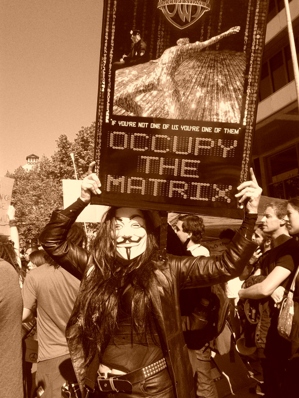 "Anonymous turns out at Occupy Sydney with ""Occupy the Matrix"" banner"